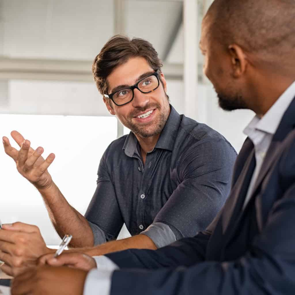Businessman discussing project with colleague